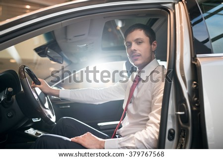 Young driver in car