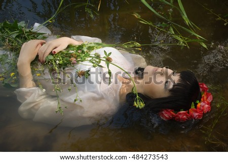 Young drown woman in a poetic representation.