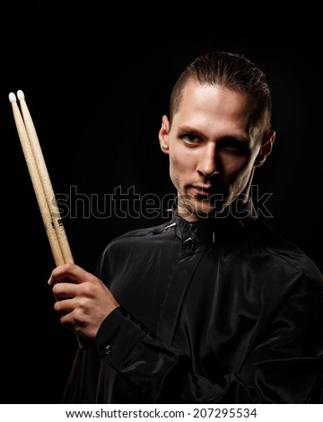 Young drummer man portrait artist of rock music - stock photo