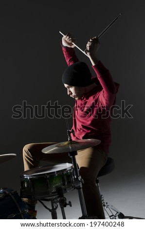 young drummer playing - stock photo