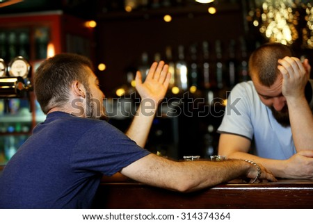 Young drunk man in bar - stock photo