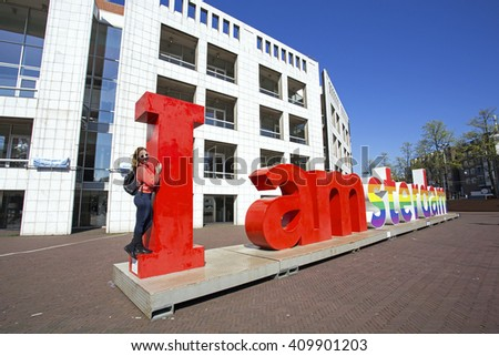 Young dutch woman with the letters I Amsterdam in Amsterdam the Netherlands