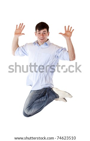 Young dynamic sportive man jumps high in the air.Isolated on white background. - stock photo
