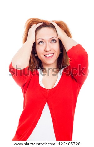 Young ecstatic happy woman in red sweater looking up, isolated on white background. - stock photo