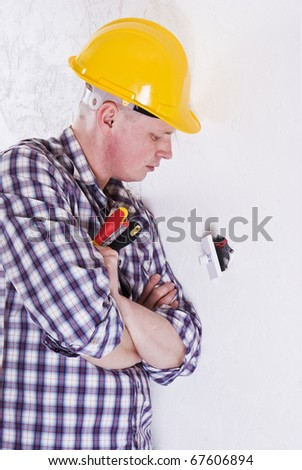 Young Electrician fitting new light switch