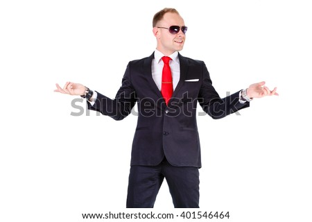 Young elegant and stylish business man in black suit, red tie, white shirt and black sunglasses, showing one side - isolated on white background. Leather bracelet and clock on man's wrist - stock photo