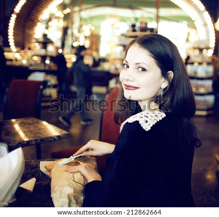 young elegant brunette woman in cafe drinking cofe - stock photo