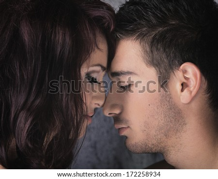 young elegant couples in the tender passion
