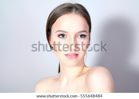 Young elegant girl with well-groomed face