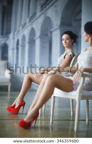 young elegant lady in front of mirror, soft focus - stock photo