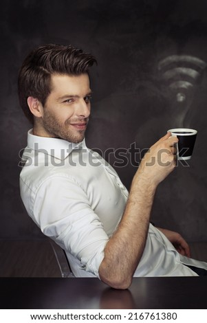 Young elegant man with cup of coffee