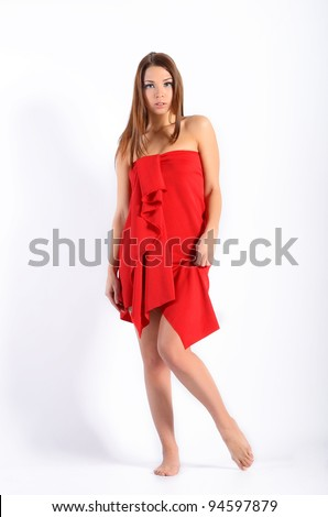 young elegant woman in red dress - stock photo