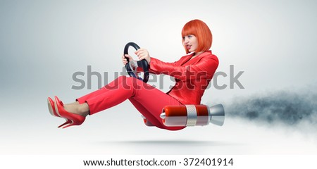 Young elegant woman in red driver car with a wheel, auto concept.