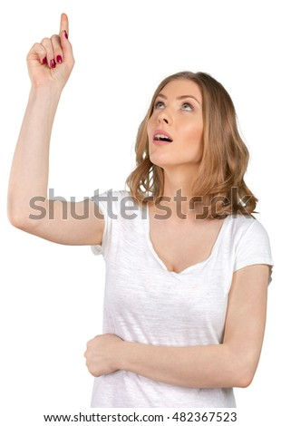 Young elegant woman pointing at white background