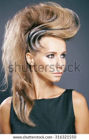young elegant woman with creative hair style zebra print close up pretty like punk - stock photo