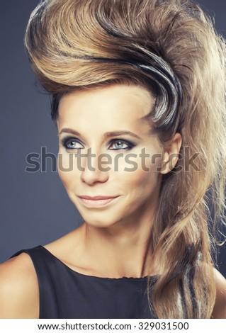 young elegant woman with creative hair style zebra print close up pretty like punk studio halloween look - stock photo