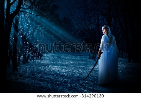 Young elven girl in night forest - stock photo