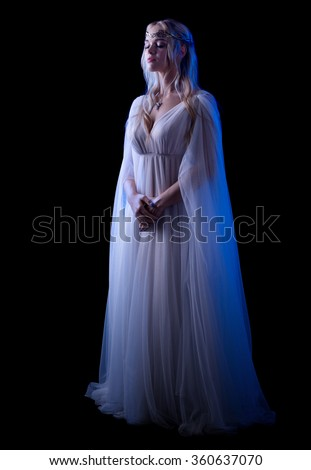 Young elven girl isolated on black - stock photo