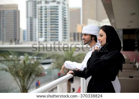 Young Emirati couple talking, Dubai, UAE - stock photo