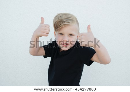 young emotional boy on bright background - stock photo
