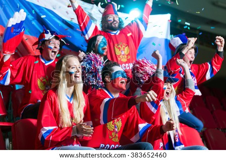 Young emotional fans in stadium - stock photo