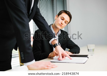 Young employee listen to his manager advice - stock photo