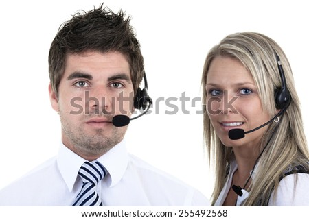 Young employee working with a headset and accompanied by his team - stock photo