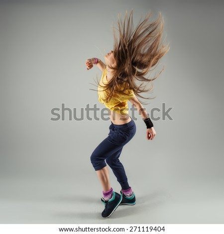 Young energetic woman jazz dancer moving in class. Beautiful slim female performer in motion.  - stock photo