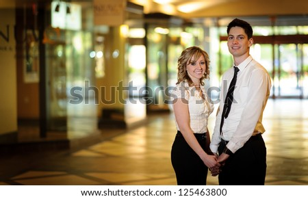 Young engaged couple - stock photo