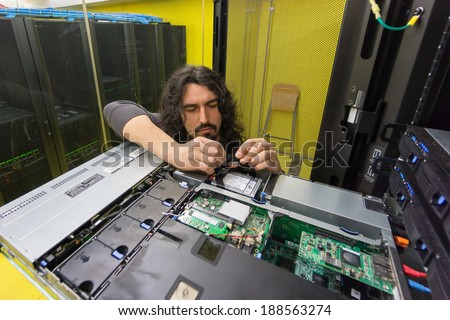 young engeneer professional technician repairing server in computer room - stock photo
