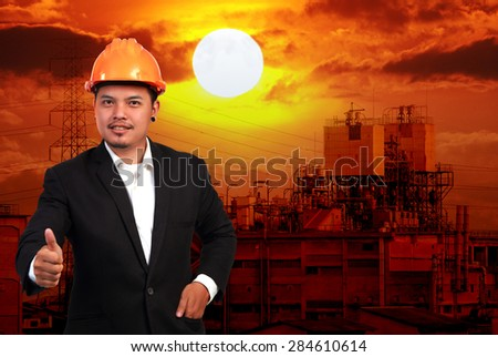 Young engineer and industrial factory - stock photo
