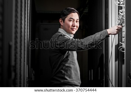 Young engineer businessman in server room - stock photo
