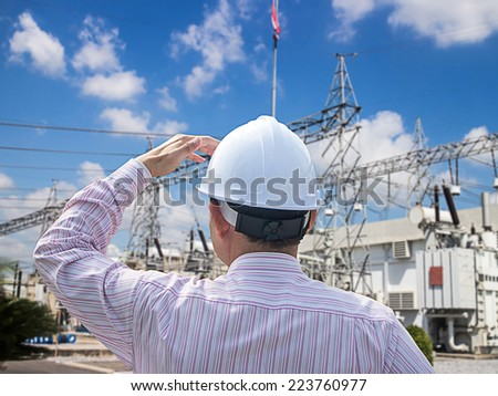 Young engineer looking work in front of substation