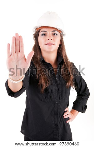 Young engineer ordering to stop with his hand - stock photo