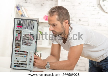 young engineer repaired a computer - stock photo