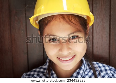 young engineer wear yellow hat