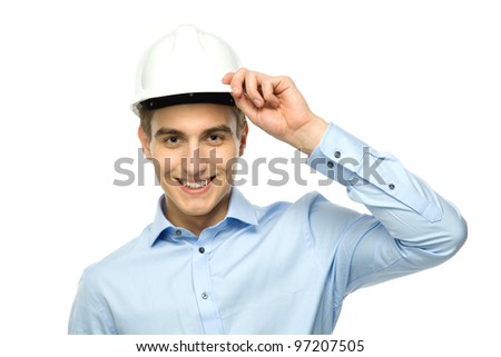 Young engineer wearing hardhat - stock photo