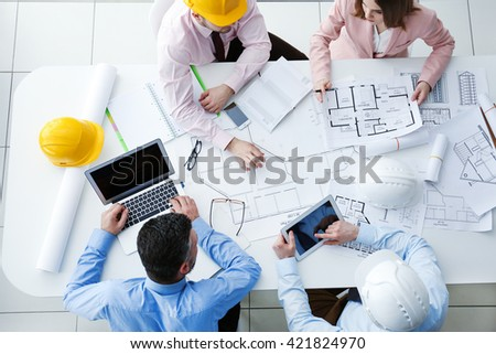 Young engineers working in the office, top view - stock photo