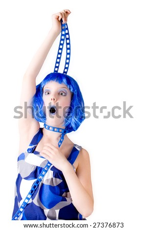 Young enthusiastic child with a blue wig shot on a white background