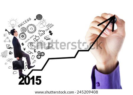 Young entrepreneur with scribble carrying briefcase and stepping upward on a graph - stock photo