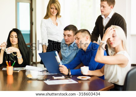 Young entrepreneurs at a business meeting. business discussion - stock photo