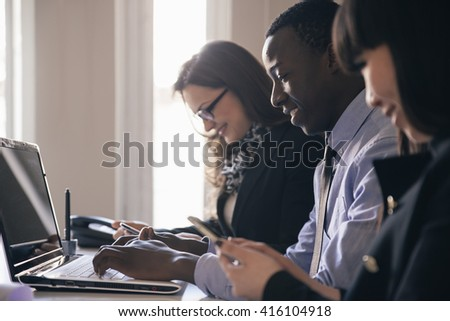 Young Entrepreneurs Working at the Office. - stock photo