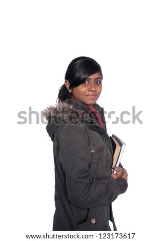 Young ethnic dark Indian high school student holding books, over white.