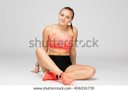 Young european caucasian track and field athlete girl portrayed in studio - stock photo