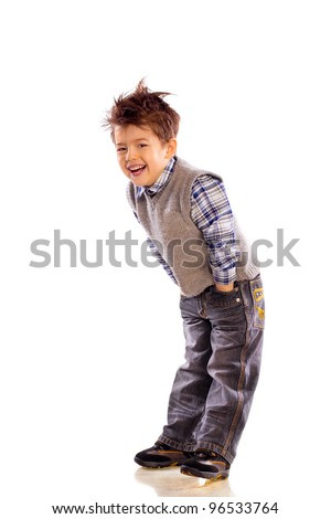 young European children laughing on white background in a knitted sweater and jeans - stock photo