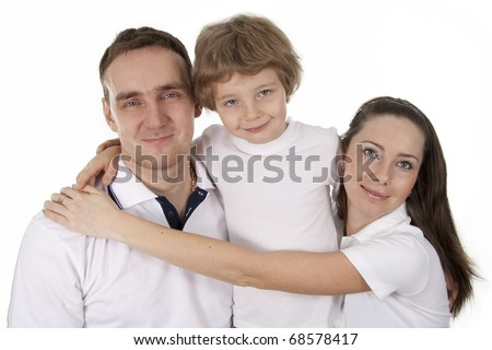 Young European family from three persons - mother, father and son.