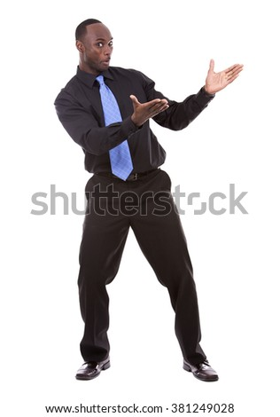 young excited casual black man  pointing hand on white background