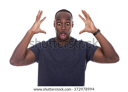young excited casual black man shocked on white background - stock photo
