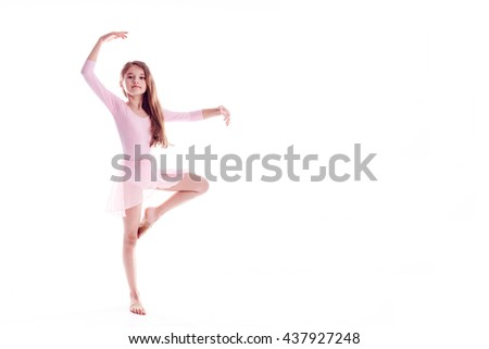 Young excited girl jumping in the studio - stock photo