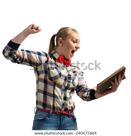 Young excited woman in casual clothing with book in hand, isolated on white